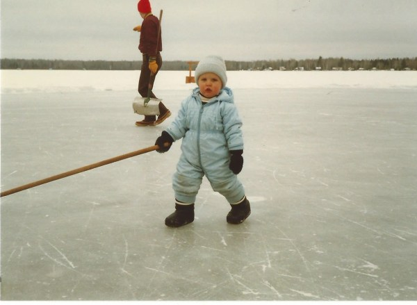 This grumpy young fella grew up to be a fine hockey player.